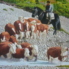 Vacas cruzando el arroyo